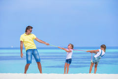 Young father and little girls have fun together Stock Photo