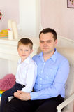 Young father and little son indoors Stock Photo