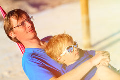 Young father and little son relaxing in hammock Stock Photography