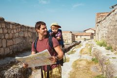 Young father with little son traveling in antic town royalty free stock photos