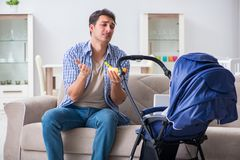 The young father looking after newborn baby at home. Young father looking after newborn baby at home stock photos