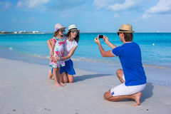Young father making photo on phone of family at royalty free stock image