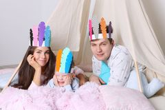 Young father, mother, little son pose in wigwam Stock Images