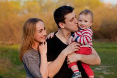 Young father and mother playing with their cute and little son Royalty Free Stock Image
