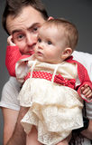 Young father with no clue on raising a child Royalty Free Stock Images