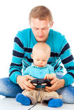 Young father playing with baby Stock Photo