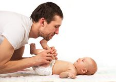 Young father playing with baby son Royalty Free Stock Images