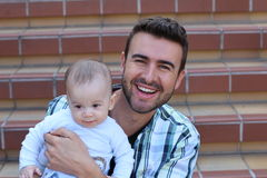 Young father playing with his little baby.  Stock Image