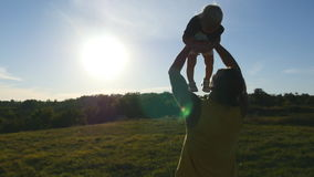 Young father playing with his little son outdoor. Dad lifting up his child at nature. Happy family spending time stock video