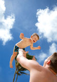 Young father playing with his son Royalty Free Stock Photos