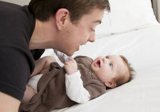 Young father playing with sweet baby girl Royalty Free Stock Photography