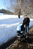 Young father with a pram Stock Images