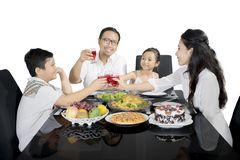Young father raises glass with his family Royalty Free Stock Photos