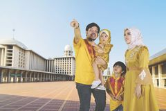 Muslim family showing something in the mosque. Young father showing something to his family while standing in the Istiqlal mosque Stock Photos
