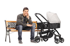 Young father sitting on bench Royalty Free Stock Image
