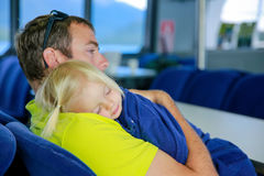 Young father with small daughter sleeping on his shoulder. Lake Te Anau, New Zealand Royalty Free Stock Image