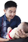 Young father smiling at baby Royalty Free Stock Image