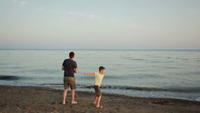 Young father and son on the beach stock footage