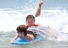 Young father and son learning to surf royalty free stock photo