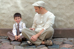 Young father and son outdoors in city Stock Photography