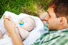 Young father with son. Outdoors in park, soft focus (focus on eyes of father Stock Images