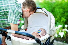 Young father with son. Outdoors in park, soft focus (focus on eyes of father Stock Photography