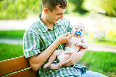 Young father with son. Outdoors in park, soft focus (focus on eyes of father Royalty Free Stock Photography
