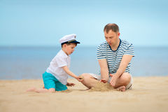 Young father and son playing on the beach Stock Image