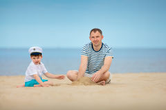 Young father and son playing on the beach Stock Photo