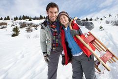 Young Father And Son In Snow With Sled Royalty Free Stock Image