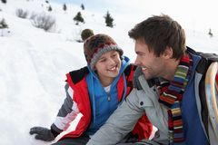 Young Father And Son In Snowy Landscape Royalty Free Stock Images