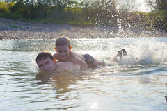 Young father and son swimming in river Stock Photo