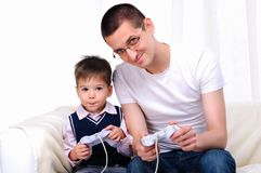 Young father and son together Stock Images