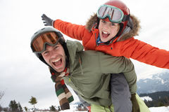 Young Father And Son On Winter Vacation. Laughing Royalty Free Stock Photography