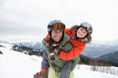 Young Father And Son On Winter Vacation. Smiling at camera Stock Photo