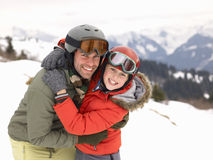 Young Father And Son On Winter Vacation. Smiling at camera hugging Stock Photo