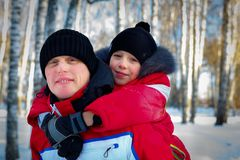 Young Father And Son In Winter Landscape. Young Father And Son On Winter Vacation Stock Image