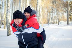 Young Father And Son In Winter Landscape. Young Father And Son On Winter Vacation Royalty Free Stock Photography