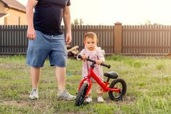 Young father spend time with Cute little one years old toddler girl child and balance bike, father`s day. Young father spend time with Cute little one years old stock images