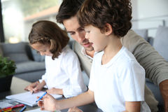 Young father spending good time with children Royalty Free Stock Photography