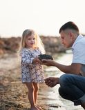 Young father spends his time with his little daughter Stock Photo