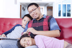 Young father spoiling his children Royalty Free Stock Photography