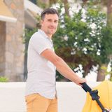 Young father strolling pushchair Royalty Free Stock Images