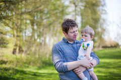 Young father and sweet baby boy in spring forest Royalty Free Stock Images