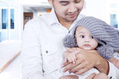 Young father take care his baby Stock Image