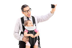 Young father taking selfie with his baby daughter Royalty Free Stock Image