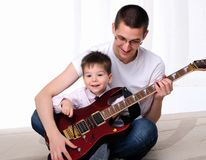 Young father teaches his young son Royalty Free Stock Photo