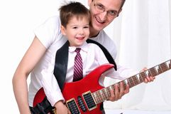 Young Father Teaches His Young Son Stock Image