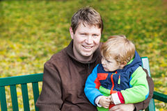 Young father and toddler boy in autumn park Stock Images