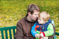 Young father and toddler boy in autumn park Stock Photos